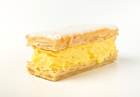Custard slice cream cake from low perspective isolated on white. Stock Photo - 8797279