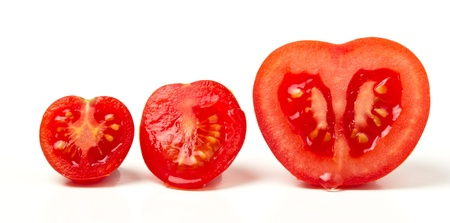 cherry tomatoes: Tomato line up of three different varieties sliced isolated on white. Stock Photo