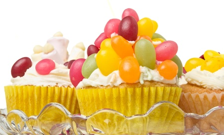 A variety of vibrant fun homemade cup cakes on cake stand. photo