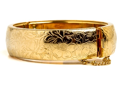 low perspective: Vintage gold bangle from low perspective isolated on white. Stock Photo