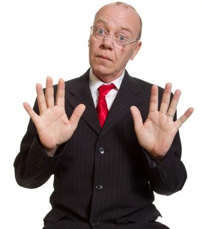 Expressive senior businessman isolated on white calm down concept