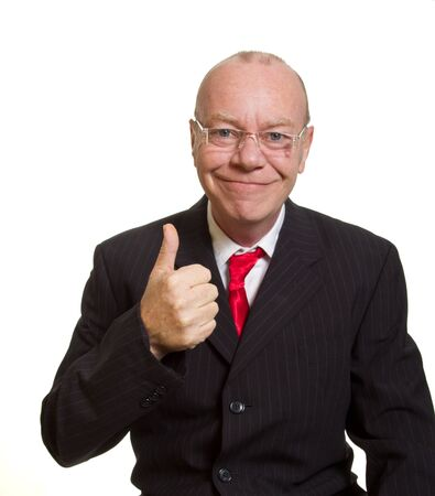 Expressive senior businessman isolated on white thumbs up concept photo