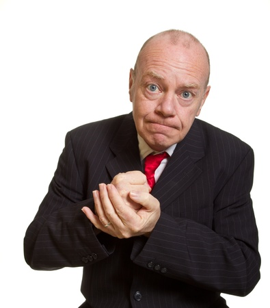 Expressive senior businessman isolated on white stern concept