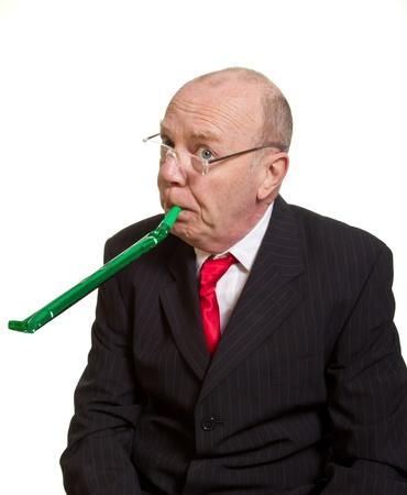 Expressive senior businessman isolated on white party pooper concept Stock Photo