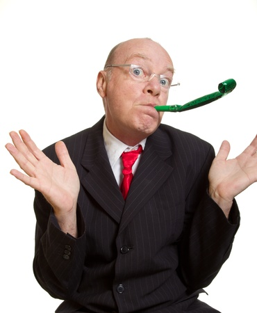blower: Expressive senior businessman isolated on white party pooper concept Stock Photo