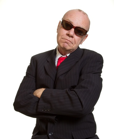 Expressive senior businessman isolated on white tough guy concept photo