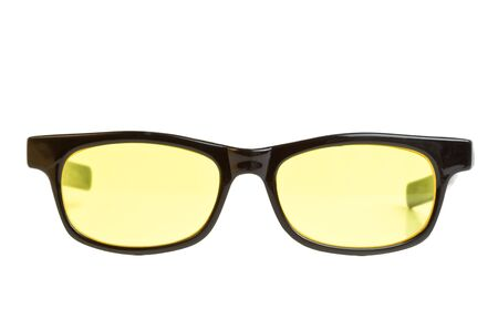 Nerdy vintage yellow lens sunglasses isolated on white from low perspective. Stock Photo - 9342392