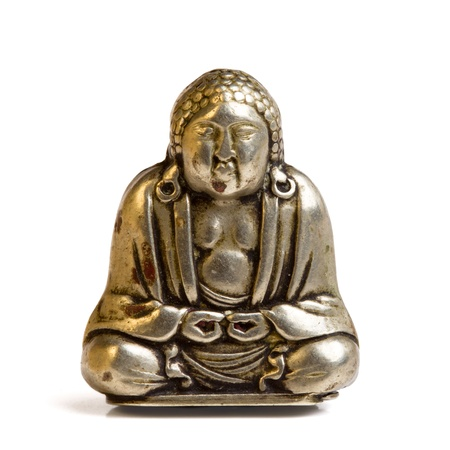 buddah: Small silver buddah isolated on white from low perspective. Stock Photo