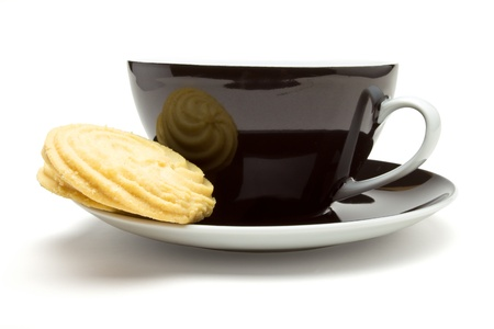 Viennese Swirl Biscuits resting on cup and saucer tea break concept. Stock Photo - 9495330