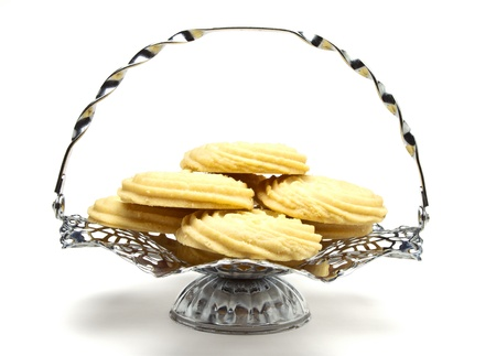 Viennese Swirl Biscuits on fancy chrome platter isolated on white. Stock Photo - 9495326