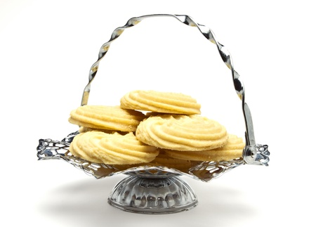 Viennese Swirl Biscuits on fancy chrome platter isolated on white. Stock Photo - 9495325