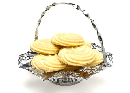 Viennese Swirl Biscuits on fancy chrome platter isolated on white. Stock Photo - 9495329