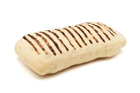 low perspective: Single toasted panini from low perspective isolated on white. Stock Photo