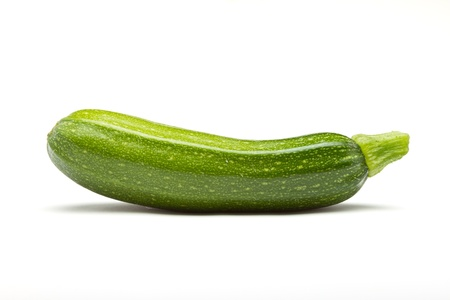 phallic: Single Courgette or zucchini from low perspective isolated on white.