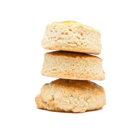 scone: Tower of plain scones from low perspective isolated on white. Stock Photo