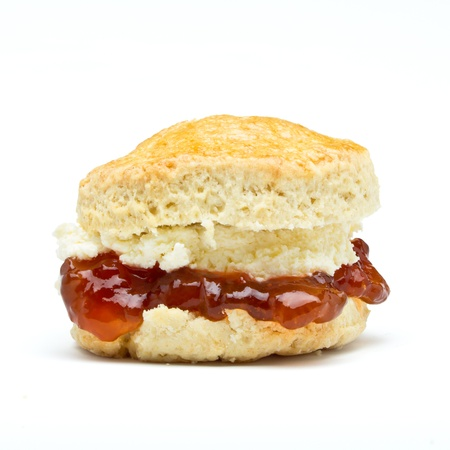 Cream tea Scone with jam from low perspective isolated on white.