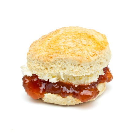 Cream tea Scone with jam from low perspective isolated on white. photo