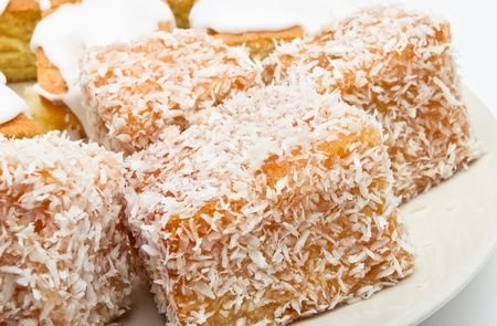 madalena: Traditional Madeleines coated in jam and covered with coconut sprinkles.