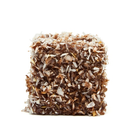 lamington: Traditional Aussie Lamington of sponge cake dipped in chocolate and rolled in dessicated coconut. Stock Photo