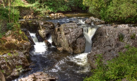 rushing water: Hdr image of Betws y Coed bridge and waterfall in Wales.