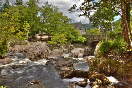 Hdr image of Betws y Coed bridge and waterfall in Wales. photo