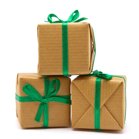 Pile of Gift boxes wrapped in brown paper isolated on white. photo