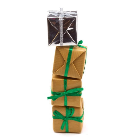 Pile of Gift boxes wrapped in brown paper isolated on white. Stock Photo - 10559690