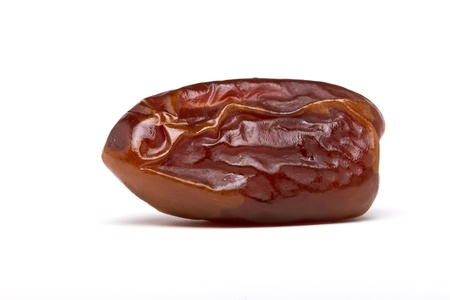 Single dried date fruit from low perspective on white background.