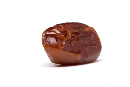 up to date: Single dried date fruit from low perspective with shallow focus.