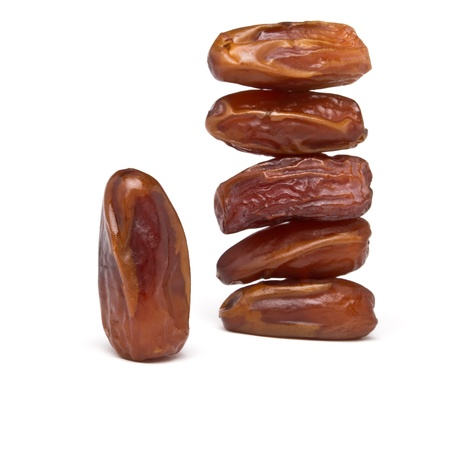 Abstract stack of date fruits on white background. Stock Photo - 11024769