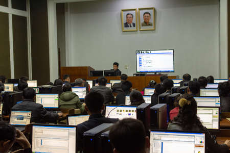 Pyongyang / DPR Korea - November 12, 2015: Students learning programming in a computer study room at the Grand People's Study House, an educational center open to all North Koreans in Pyongyang