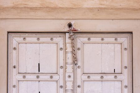 Old white door, architectural detail in Historical Agra Fort of the Mughal dynasty emperors,  in Agra, Uttar Pradesh, India