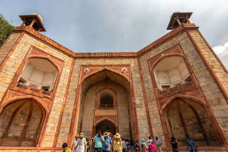 Delhi / India - September 21, 2019: The West Gate public entrance to the Humayun's tomb, the mausoleum of the Mughal Emperor Humayun in Delhi, India