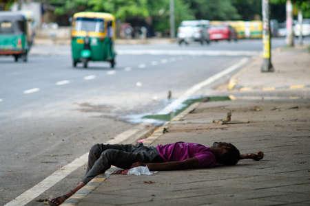 Poor Homeless man sleeping on sidewalk in New Delhi, India Editorial