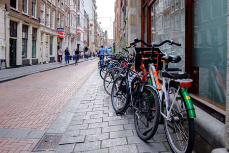Amsterdam / Netherlands - October 15, 2018: Bicycles parked in the street in Amsterdam, capital of Netherlands