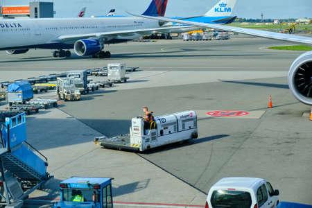 Amsterdam / Netherlands - October 7, 2018: Airport baggage tractor at Amsterdam Airport Schiphol in Amsterdam, Netherlands