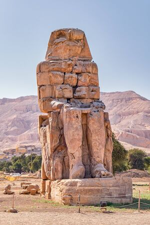 Colossi of Memnon, massive stone statues of the Pharaoh Amenhotep III in the Valley of Kings, Luxor, Egypt.