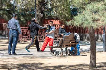 Beijing / China - April 3, 2016: People practicing kung fu in Ritan park in Beijing, China