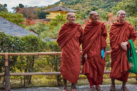 Kyoto / Japan - November 12, 2017: Buddhist monks standing in front of Kinkakuji temple Gooden Pavilion, Zen Buddhist temple in Kyoto, Japan, UNESCO world heritage site Editorial