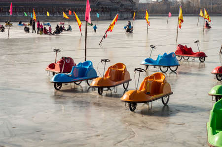 Beijing / China - January 11, 2015: Sledges for sliding over iced surface of frozen Beihai lake in Beijing, China