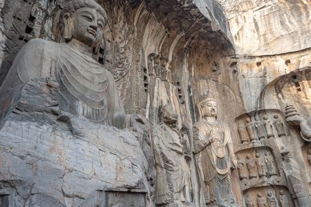 The Longmen Grottoes, Longmen Caves with statues of Buddha and his disciples carved in stone in Luoyang, Henan province, China Standard-Bild