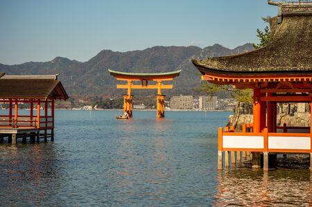 Itsukushima Shinto Shrine in Miyajima island with its floating red torii gate Japan