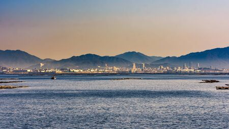 Scenic view of Hiroshima bay of the Seto Inland sea of Japan, with Hiroshima city in the distance, Japan Stok Fotoğraf