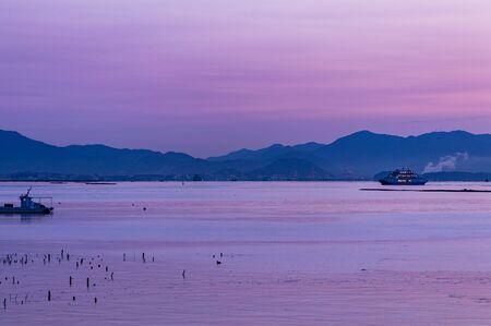 Beautiful purple dawn sunrise over Hiroshima bay, Seto Inland sea of Japan, Hiroshima, Japan
