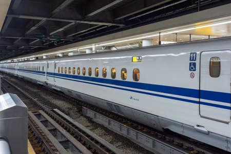 Tokyo / Japan - October 22, 2017: N700 Series Shinkansen high-speed bullet train of Japan Railway Company (JR) at Tokyo Station in Tokyo, Japan Editorial