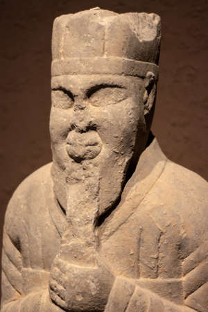 Luoyang, Henan Province / China - January 5, 2016: Ancient stone statue of nobleman, exhibition of ancient stone carving art in Luoyang Museum in Luoyang, China Editorial