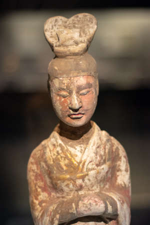 Luoyang, Henan Province / China - January 5, 2016: Ancient stone statue of nobleman, exhibition of ancient stone carving art in Luoyang Museum in Luoyang, China
