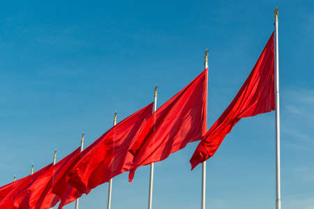 Red banners unfurled in the wind at Tiananmen square ahead of the National Day celebration (65th Anniversary of the Founding of the People's Republic of China).