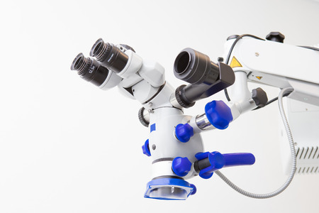 Image of a professional dental endodontic binocular microscope on a white background