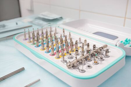 A set of tools for dental implantation. Drills, extenders and wrenches for implant installation.